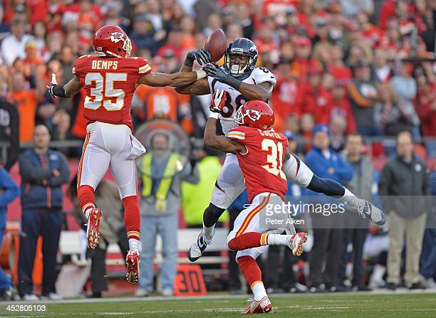 Safety Quintin Demps of the Kansas City Chiefs intercepts a deflected pass intended for wide receiver Demaryius Thomas of the Denver Broncos during...