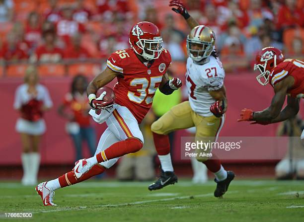 Safety Quintin Demps of the Kansas City Chiefs returns a kickoff 104yards for a touchdown against the San Francisco 49ers during the first half on...