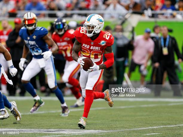 Safety Reshad Jones of the Miami Dolphins from the AFC Team runs back an interception during the NFL Pro Bowl Game at Camping World Stadium on...