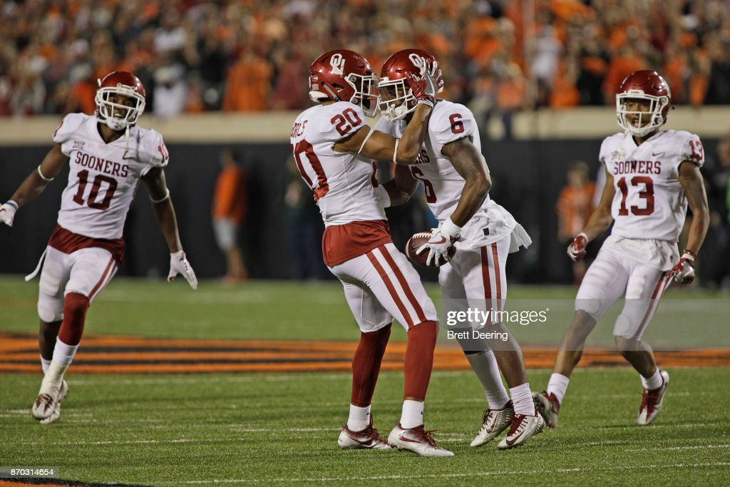Safety Robert Barnes #20 and cornerback Tre Brown #6 of the Oklahoma Sooners at Boone Pickens Stadium on November 4, 2017 in Stillwater, Oklahoma. Oklahoma defeated Oklahoma State 62-52.