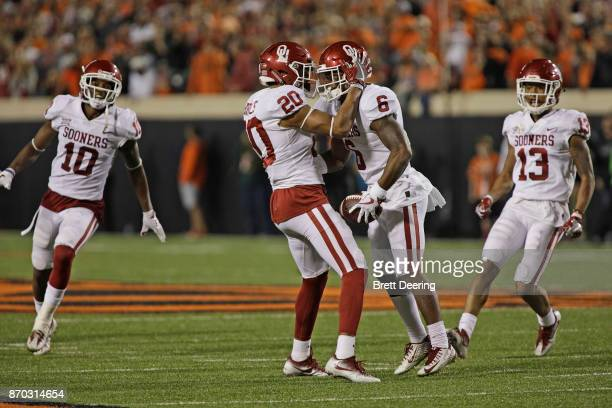 Safety Robert Barnes and cornerback Tre Brown of the Oklahoma Sooners at Boone Pickens Stadium on November 4 2017 in Stillwater Oklahoma Oklahoma...