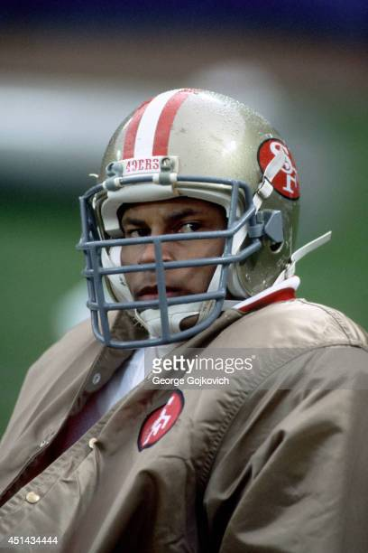 Safety Ronnie Lott of the San Francisco 49ers looks on from the sideline during a game against the Cleveland Browns at Municipal Stadium on November...