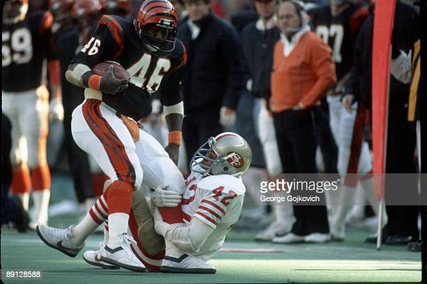 Safety Ronnie Lott of the San Francisco 49ers tackles running back Pete Johnson of the Cincinnati Bengals at Riverfront Stadium on December 6 1981 in...