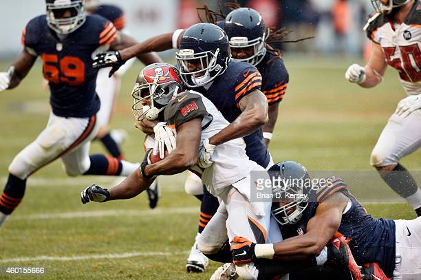 Safety Ryan Mundy of the Chicago Bears and defensive end Cornelius Washington tackle wide receiver Marcus Thigpen of the Tampa Bay Buccaneers during...
