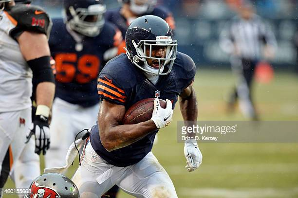 Safety Ryan Mundy of the Chicago Bears runs with the ball during the NFL game against the Tampa Bay Buccaneers on November 23 2014 at Soldier Field...