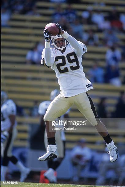 Safety Sammy Knight of the New Orleans Saints catches a pass prior to playing against the Seattle Seahawks at Husky Stadium in Seattle Washington on...