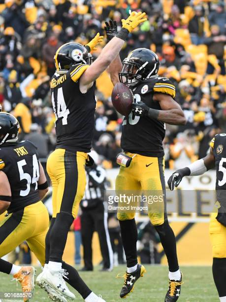 Safety Sean Davis and linebacker Tyler Matakevich of the Pittsburgh Steelers celebrate an interception by Davis in the fourth quarter of a game on...