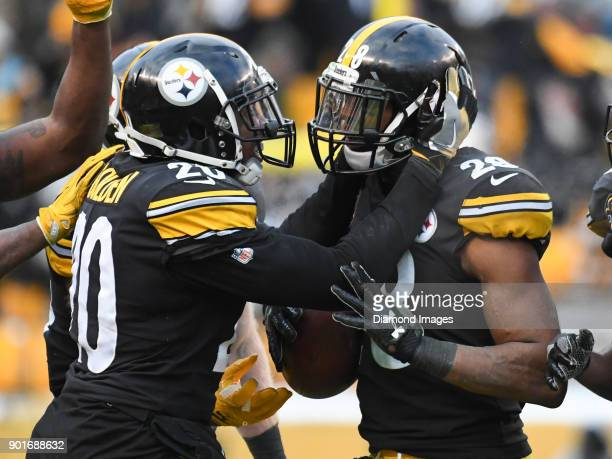 Safety Sean Davis of the Pittsburgh Steelers celebrates intercepting a pass with safety Robert Golden in the fourth quarter of a game on December 31...