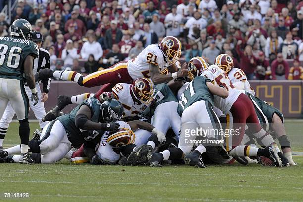 Safety Sean Taylor of the Washington Redskins leaps on top of the pile trying to stop quarterback Donovan McNabb of the Philadelphia Eagles from...