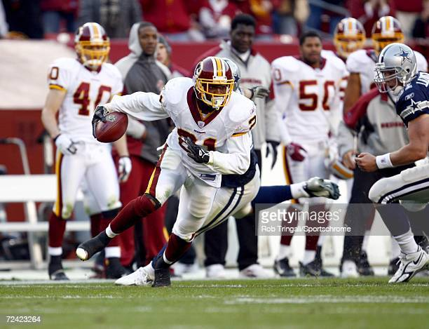 Safety Sean Taylor of the Washington Redskins runs with the ball after a blocked field goal on the last play of the 4th quarter against the Dallas...