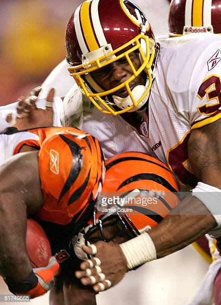 Safety Sean Taylor of the Washington Redskins tackles running back Rudi Johnson of the Cincinnati Bengals during the first half of the game at Fed Ex...