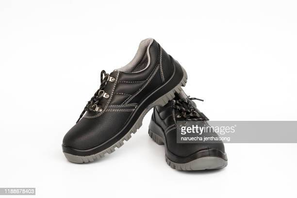 safety shoe black work boots on white background. construction safety equipment - black boot stock pictures, royalty-free photos & images