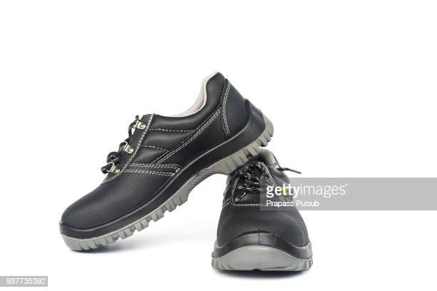 safety shoe black work boots on white background - ブーツ ストックフォトと画像