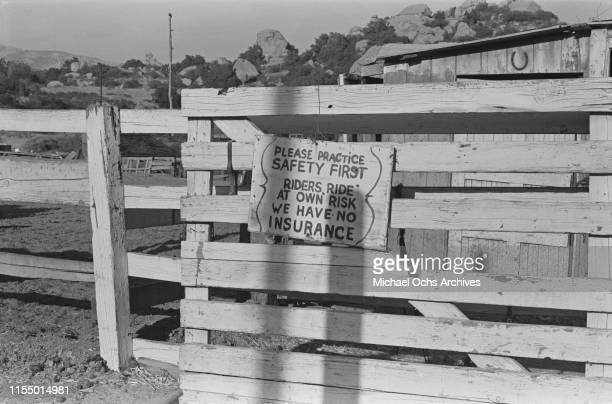 A safety sign at the entrance of a fence at the Spahn Movie Ranch owned by American rancher George Spahn and residence of the Manson Family Los...