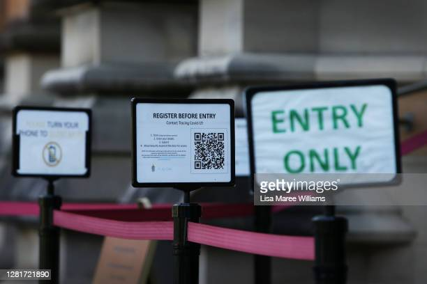 Safety signage is seen at the entrance of St Mary's Cathedral on October 23, 2020 in Sydney, Australia. Religious communities across New South Wales...