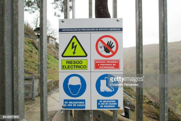 Safety signs on metal fence