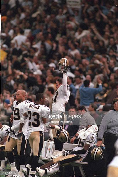 Safety Steve Gleason of the New Orleans Saints celebrates on the bench against the St Louis Rams in the 2000 NFC Wild Card Game at the Superdome on...