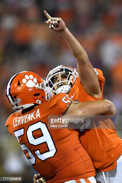 Safety Tanner Muse and defensive tackle Jordan Williams of the Clemson Tigers celebrate after Muse makes an interception against the Georgia Tech...