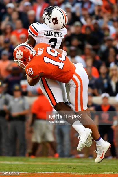 Safety Tanner Muse of the Clemson Tigers hits wide receiver Nate CraigMyers of the Auburn Tigers as he brings in the football for a reception against...