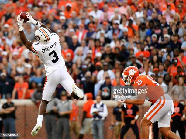 Safety Tanner Muse of the Clemson Tigers lies in wait as wide receiver Nate CraigMyers of the Auburn Tigers brings in the football for a reception...