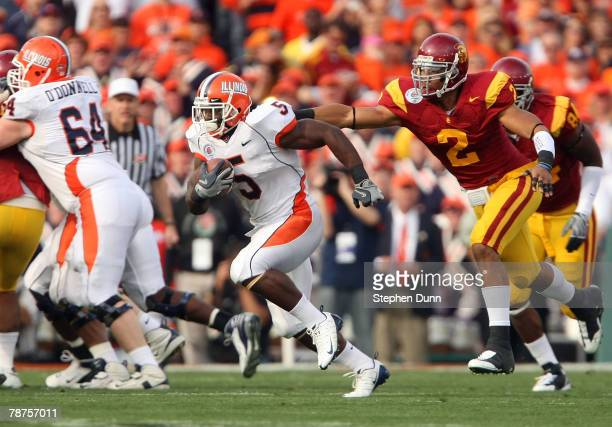 Safety Taylor Mays of the USC Trojans tackles Rashard Mendenhall of the Illinois Fighting Illini by the collar in the first half during the Rose Bowl...