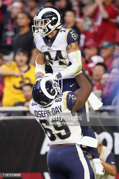 Safety Taylor Rapp of the Los Angeles Rams is hoisted in the air by defensive tackle Sebastian Joseph-Day after an interception touchdown against the...