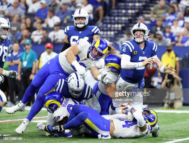 Safety Taylor Rapp of the Los Angeles Rams tackles quarterback Carson Wentz of the Indianapolis Colts in the first half of the game at Lucas Oil...
