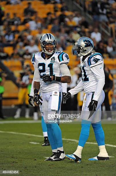 Safety Thomas DeCoud of the Carolina Panthers talks to safety Roman Harper during a preseason game against the Pittsburgh Steelers at Heinz Field on...