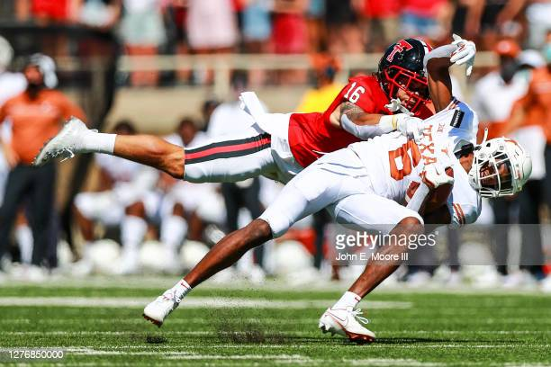 Safety Thomas Leggett of the Texas Tech Red Raiders tackles receiver Joshua Moore of the Texas Longhorns during the first half of the college...