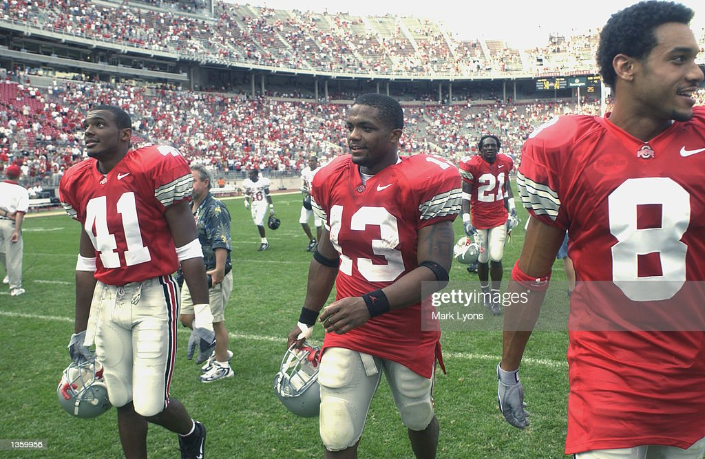 Safety Thomas Matthews #41, running back Maurice Clarett #13 and split end Drew Carter #8 of the Ohio State Buckeyes walk off the field after winning the NCAA Pigskin Classic against the Texas Tech Red Raiders on August 24, 2002 at Ohio Stadium in Columbus, Ohio. Ohio State defeated Texas Tech 45-21.