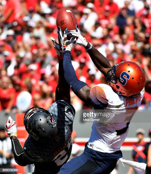 Safety Tim KiddGlass of the North Carolina State Wolfpack breaks up a pass intended for wide receiver Ervin Philips of the Syracuse Orange in the end...