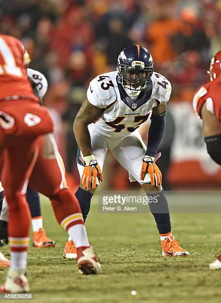 Safety TJ Ward of the Denver Broncos gets set on defense against the Kansas City Chiefs during the second half on November 30 2014 at Arrowhead...