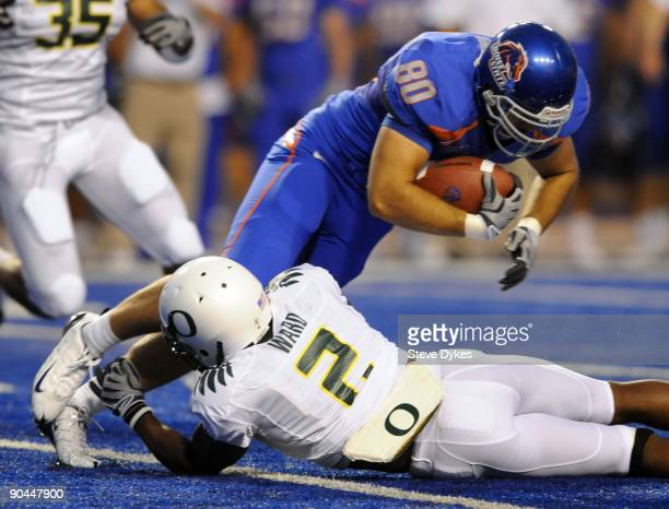 Safety TJ Ward of the Oregon Ducks tackles tight end Kyle Efaw of the Boise State Broncos in the second quarter of the game on September 3 2009 at...