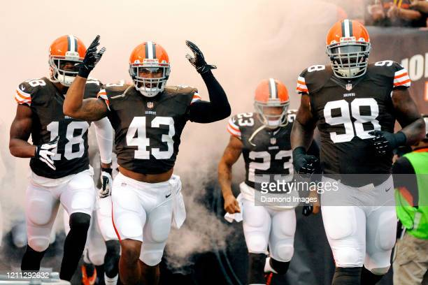 Safety T.J. Ward, wide receiver Greg Little, cornerback Joe Haden and defensive tackle Phil Taylor of the Cleveland Browns run out of the tunnel as...