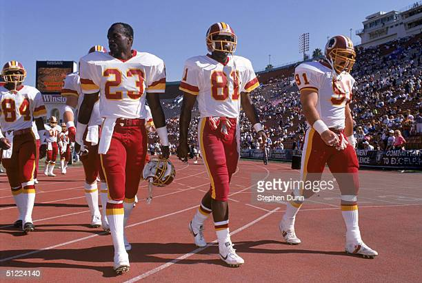 Safety Todd Bowles and wide receiver Art Monk of the Washington Redskins walk off the field during a game against the Los Angeles Raiders at Los...