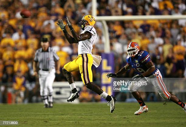 Safety Tony Joiner of the Florida Gators watches as wide receiver Brandon LaFell of the LSU Tigers goes up for a reception at Tiger Stadium on...