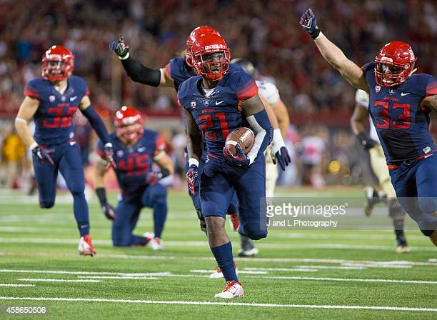 Safety Tra'Mayne Bondurant of the Arizona Wildcats recovers a fumble and returns it for a touchdown at Arizona Stadium on November 8 2014 in Tucson...