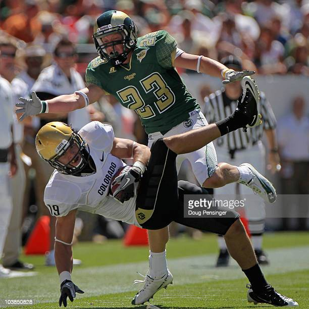 Safety Travis Sandersfield of the Colorado Buffaloes intercepts a pass intended for Tyson Liggett of the Colorado State Rams during the the Rocky...