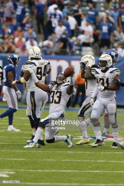 Safety Tre Boston of the Los Angeles Chargers has an interception in action against the New York Giants during an NFL game at MetLife Stadium on...