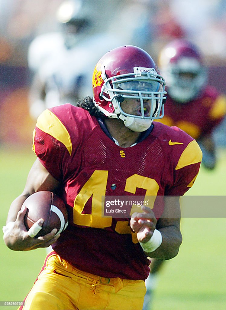 d2cf8d4394f USC safety Troy Polamalu looks for daylight after intercepting a pass by Washington  quarterback Cody