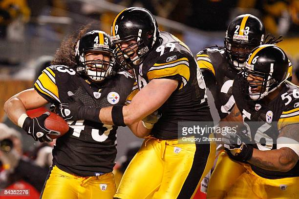Safety Troy Polamalu of the Pittsburgh Steelers celebrates his touchdown with defensive end Brett Keisel, safety Tyrone Carter and linebacker LaMarr...