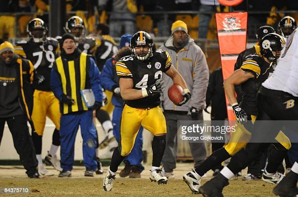 Safety Troy Polamalu of the Pittsburgh Steelers returns an interception 40 yards for a touchdown against the Baltimore Ravens during the AFC...