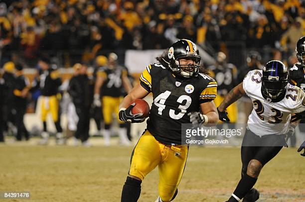 b80a02fa46a Safety Troy Polamalu of the Pittsburgh Steelers returns an interception 40  yards for a touchdown against