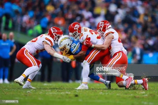 Safety Tyrann Mathieu of the Kansas City Chiefs tackle Running back Austin Ekeler of Los Angeles Chargers during the second half of a match against...