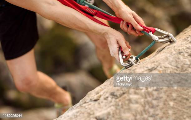 safety while rock climbing - nicky pende foto e immagini stock