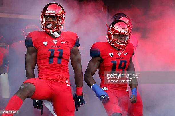 Safety Will Parks and cornerback DaVonte' Neal of the Arizona Wildcats react as they are introduced to the college football game against the UCLA...