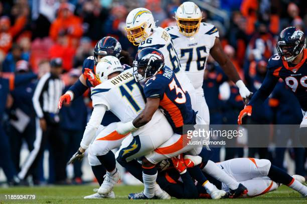 Safety Will Parks of the Denver Broncos sacks quarterback Philip Rivers of the Los Angeles Chargers during the first quarter at Empower Field at Mile...