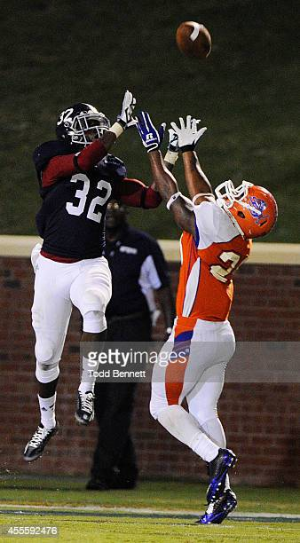 Safety William Bussey of the Georgia Southern Eagles breaks up a pass intended for running back Joshua Berry of the Savannah State Tigers on...