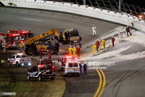 Safety workers clean up the track after a jet dryer burst into flames after being hit under caution by Juan Pablo Montoya driver of the Target...