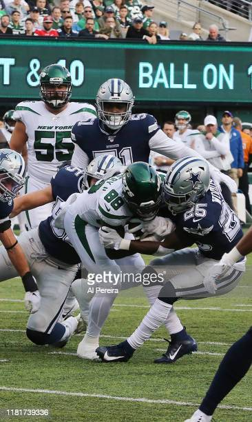 Safety Xavier Woods of the Dallas Cowboys makes a tackle against the New York Jets in the first half at MetLife Stadium on October 13 2019 in East...